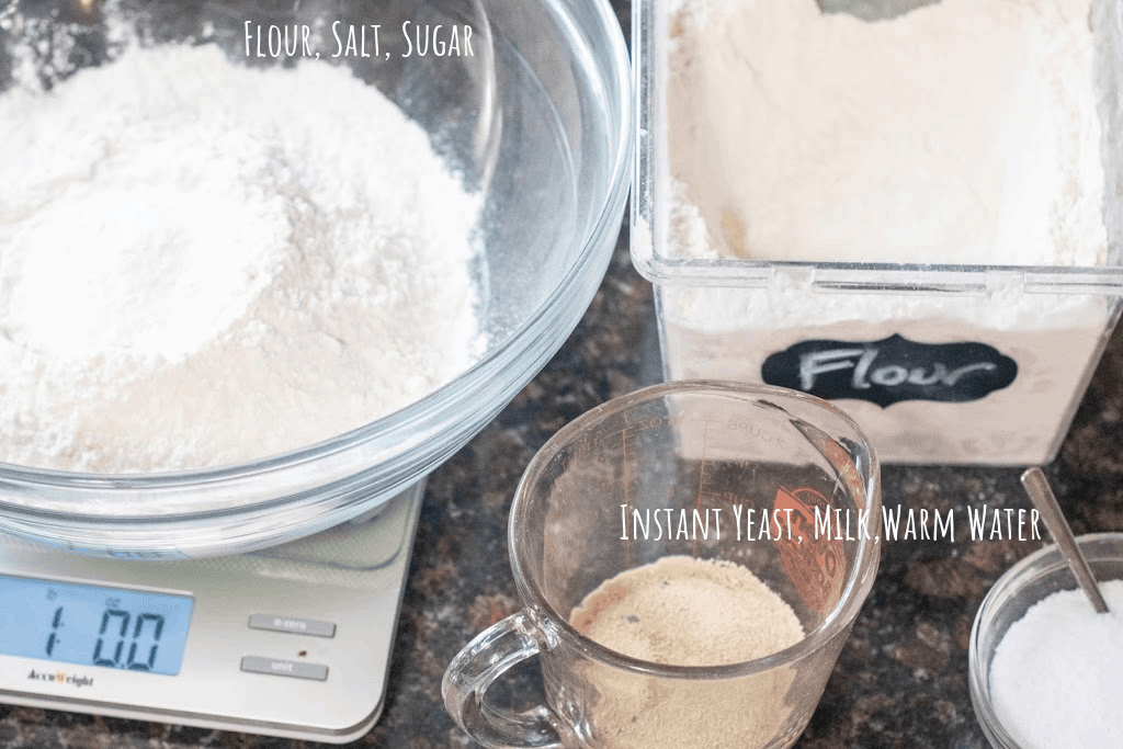 bowl of flour, yeast in cup with milk and water