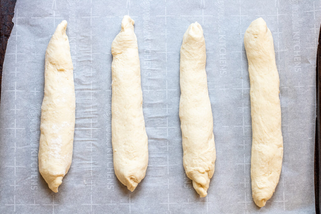 rolled baguette dough on baking sheet
