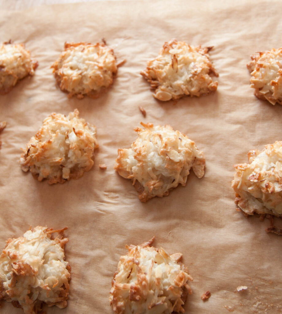 baked coconut macaroons on parchment paper.