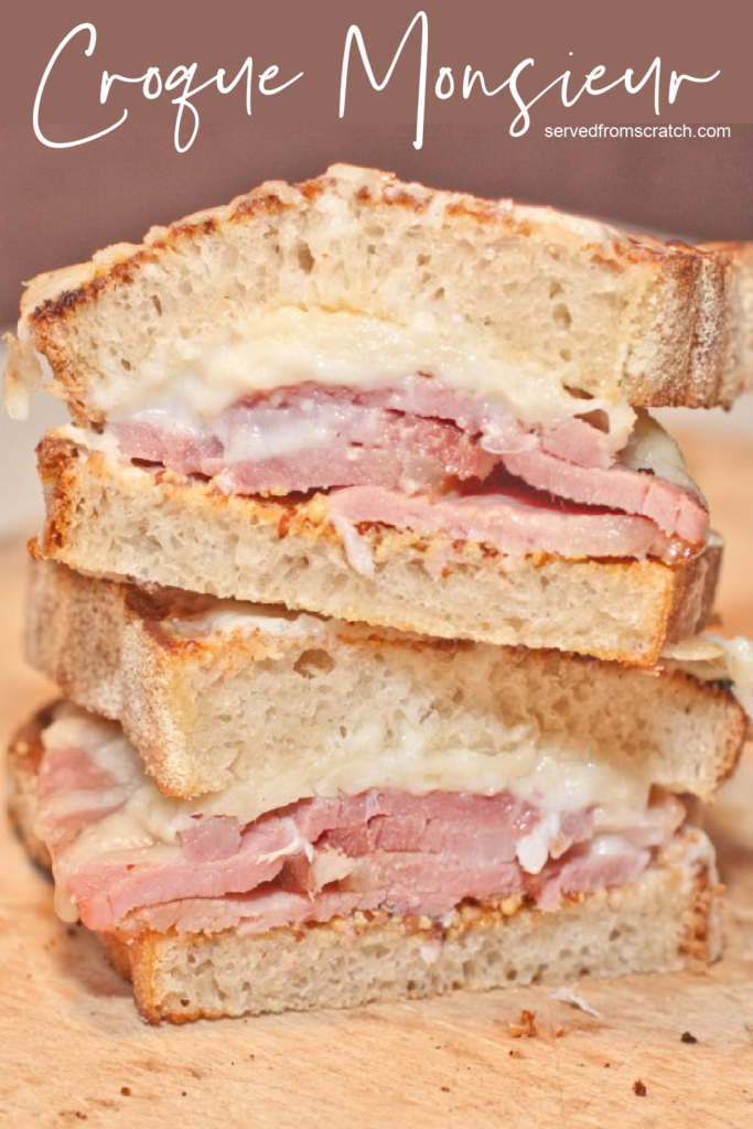stacked ham and cheese sandwich sliced in half with Pinterest pin text.