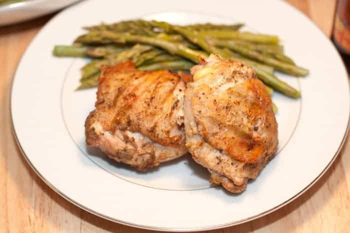 a plate with grilled chicken and asparagus