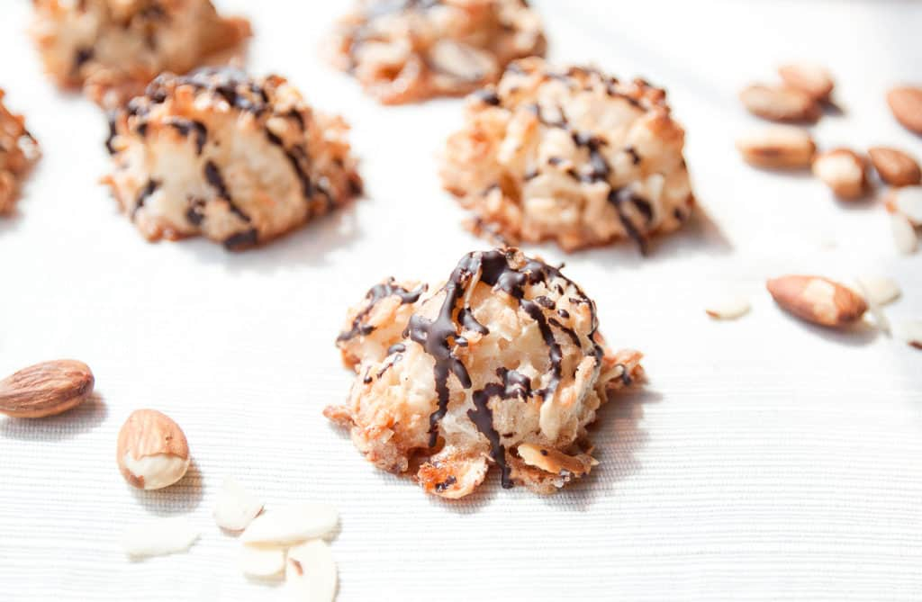almond coconut macaroons baked and on table with almonds