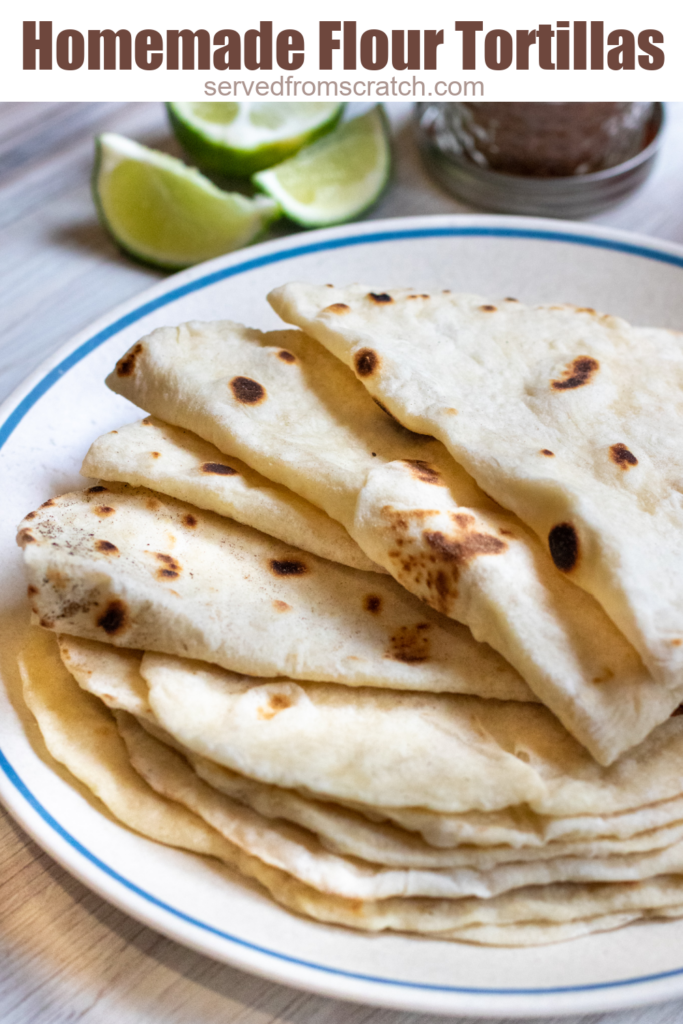 a plate of folded flour tortillas with Pinterest pin text.