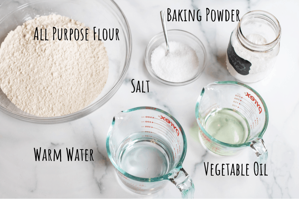 a bowl of flour, with pyrek dishes of water, vinegar, and baking soda, and salt.