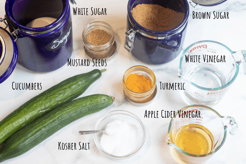 cucumbers, jars of sugar, spices, and pyrek with vinegars.