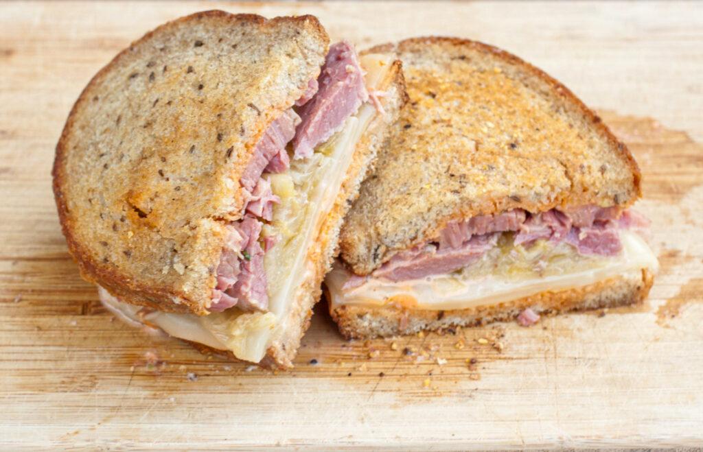 Rueben sandwich sliced in half