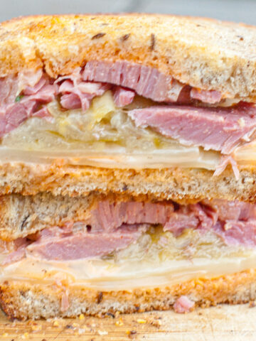 a halved and stacked corned beef sandwich