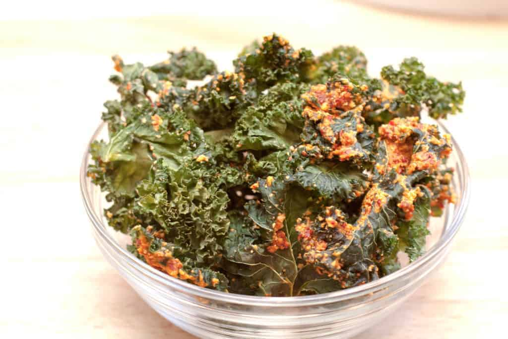 a bowl of chunky kale chips.