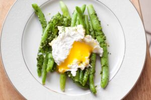 Parsley Pesto Green Beans topped with a poached egg!