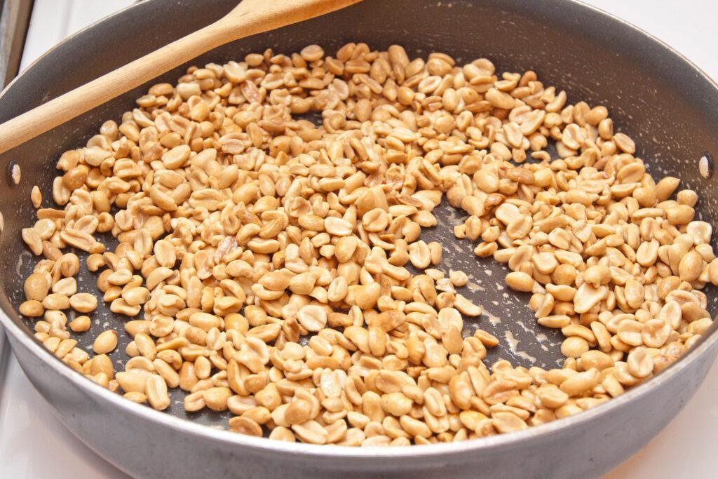 peanuts roasting in a pan.