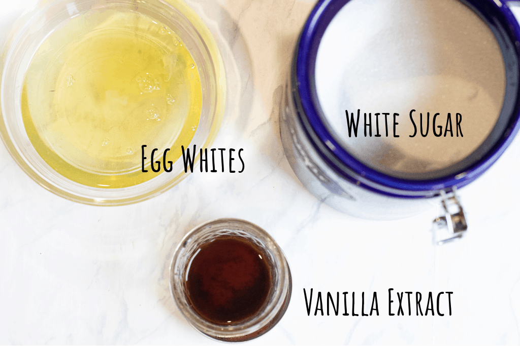 egg whites in a bowl, sugar, and vanilla extract