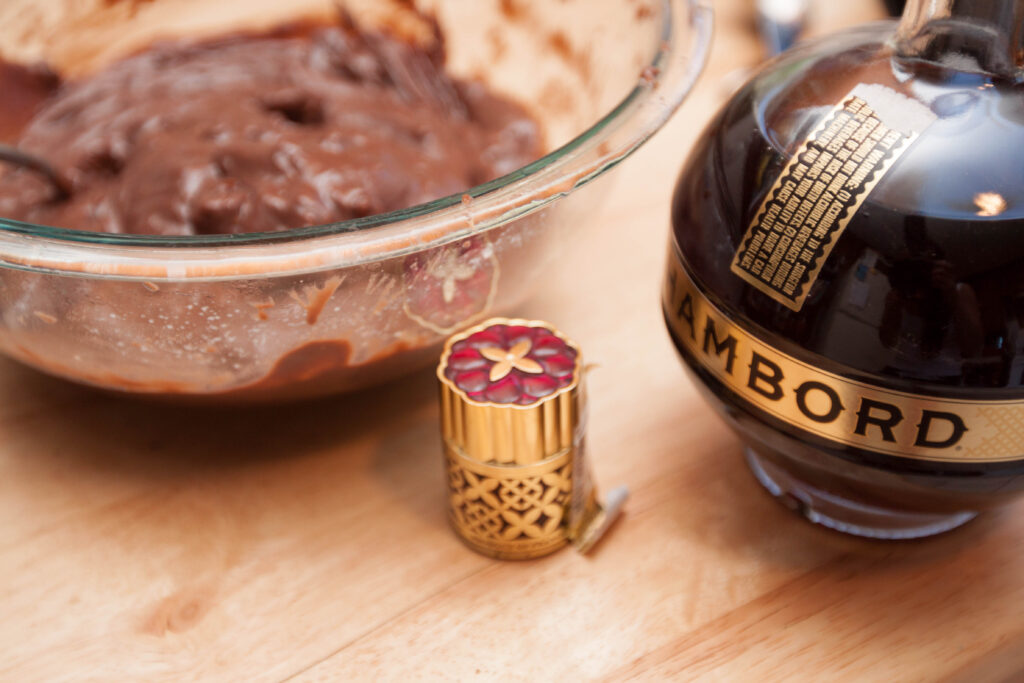 a bowl of chocolate pudding next to a bottle of Chamboard.