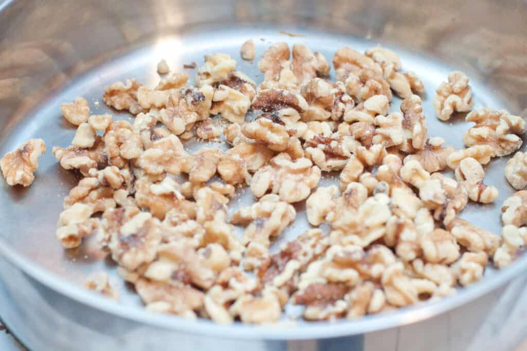 walnuts in a pan toasting.