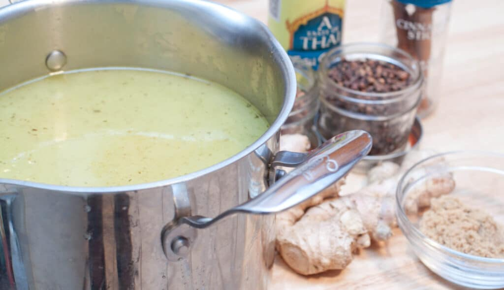 a pot of chicken stock, fish sauce, star anise, ginger, brown sugar, ci fish sauce, star anise, ginger, brown sugar, cinnamon.