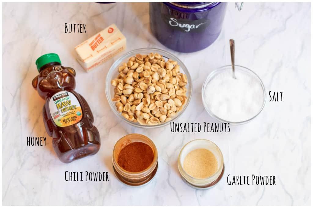 honey, peanuts, sugar, chili powder, garlic powder, butter, salt on counter.