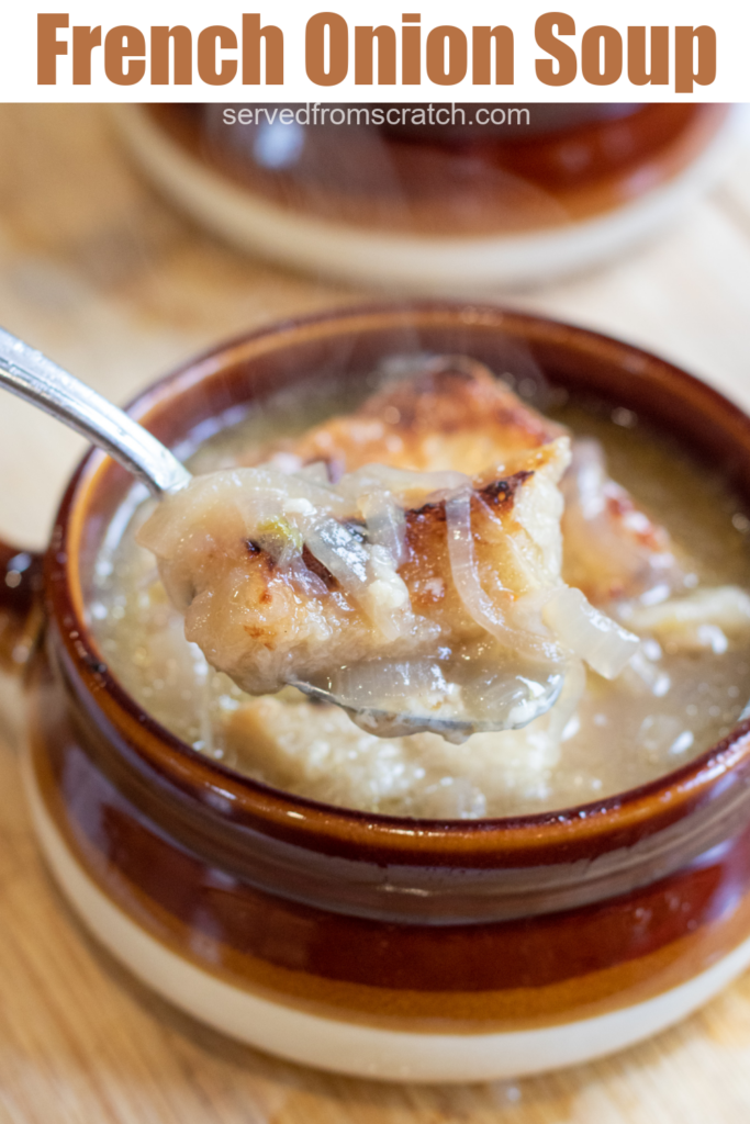crock of soup with onions and bread with Pinterest pin text.