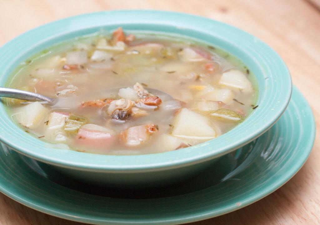 bowl of clear broth chowder