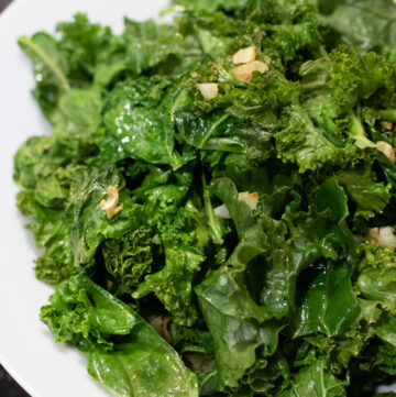 cooked garlic kale in a bowl.