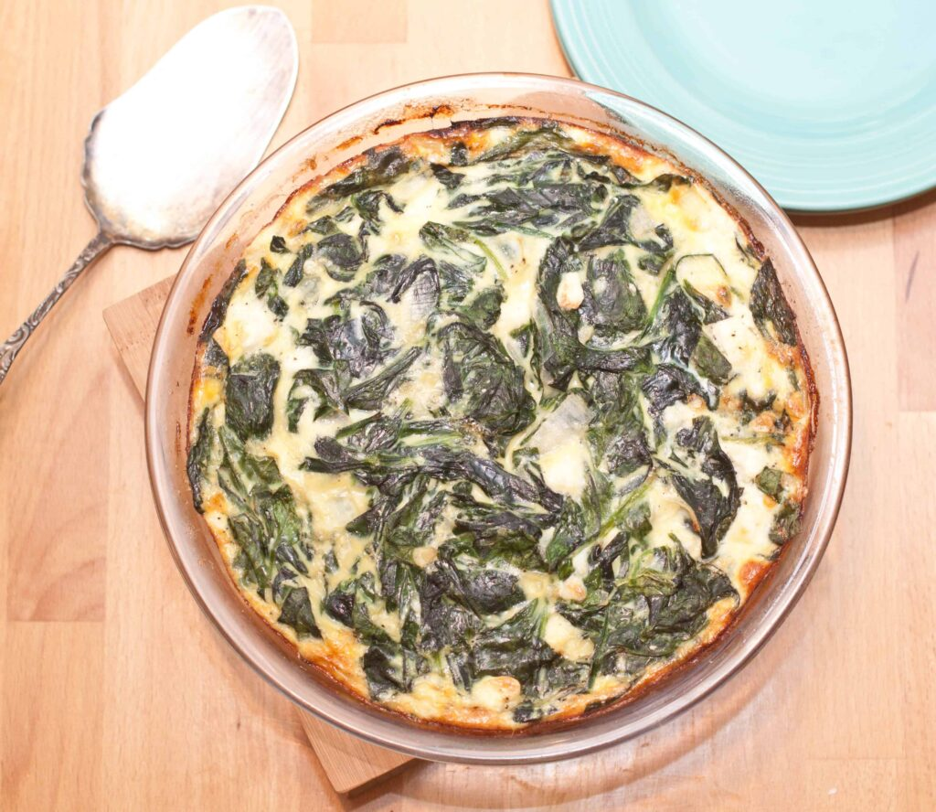 overhead of a cooked spinach quiche