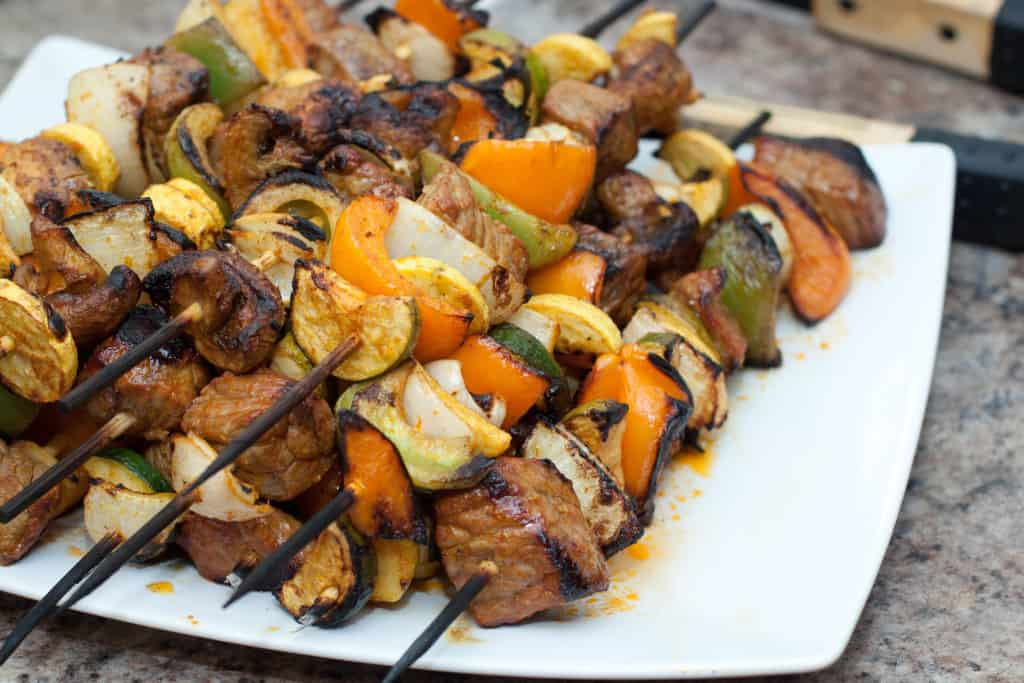 grilled spicy beef and veggie skewers on a plate