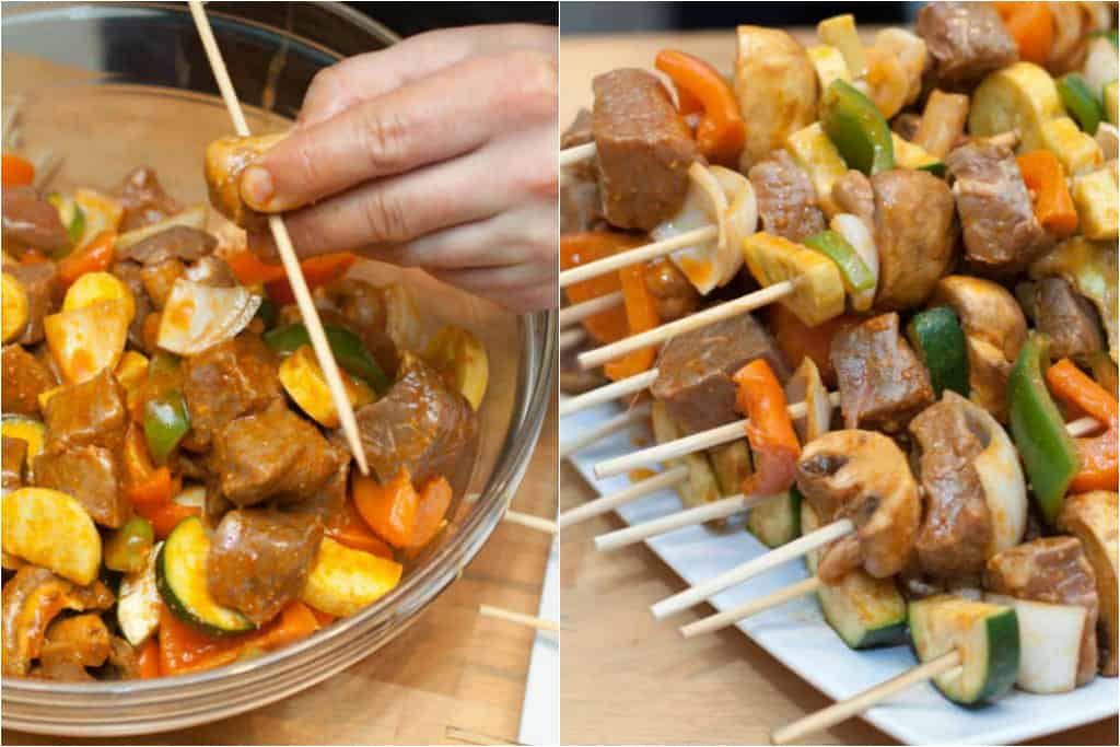 marinated beef and veggies in a bowl being skewered and stacked finished skewers