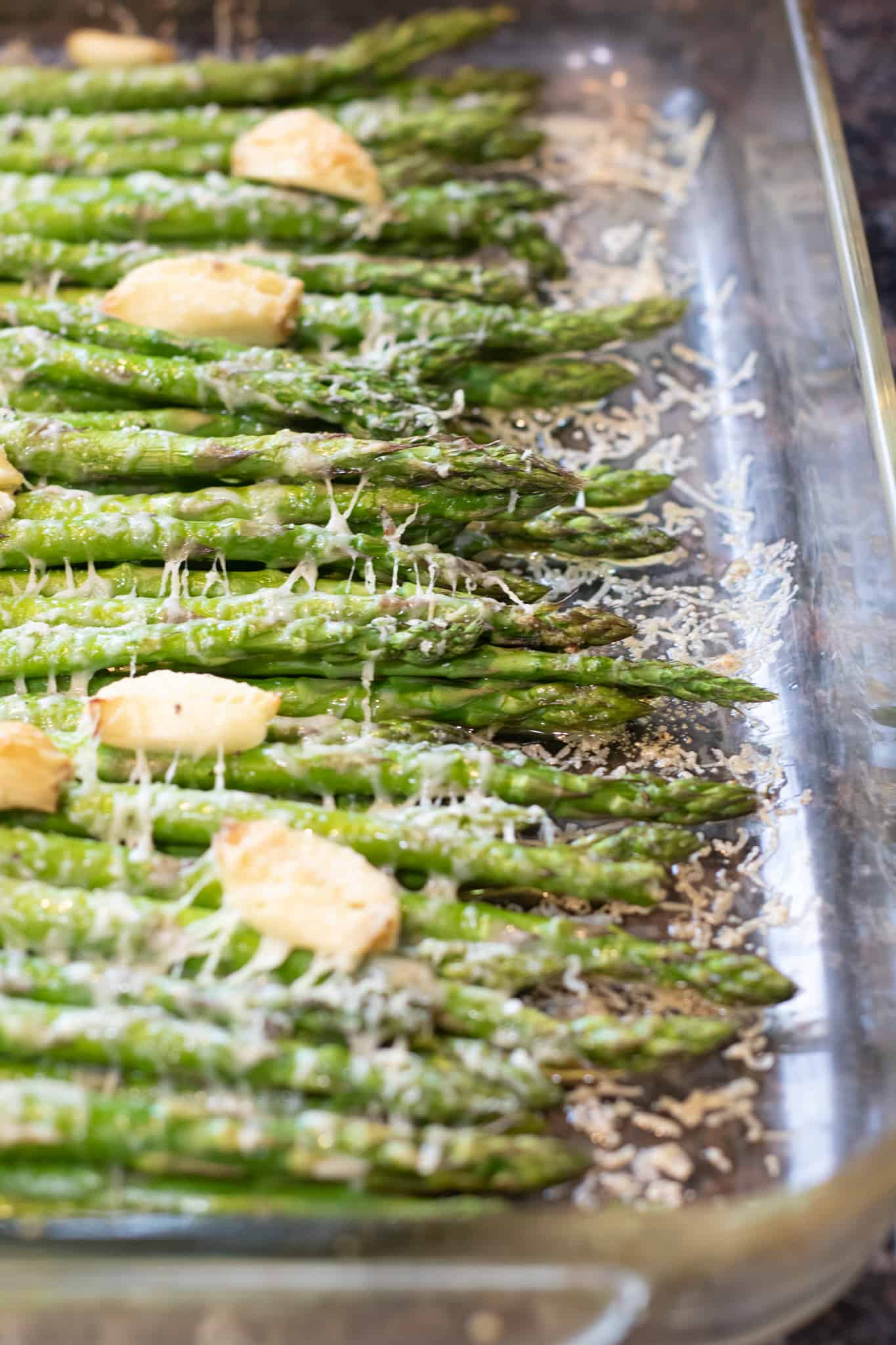 These Garlic and Gruyere Roasted Asparagus are an incredibly easy side dish to make that's full of flavor from fresh garlic and cheese! #asparagus #roasted #oven #recipes #glutenfree