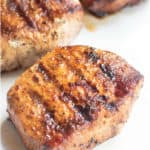 These Grilled Boneless Pork Chops are marinated in a homemade steak seasoning then grilled to juicy perfection! #porkchops #grilled #recipe #marinade #bonelessporkchops #easy