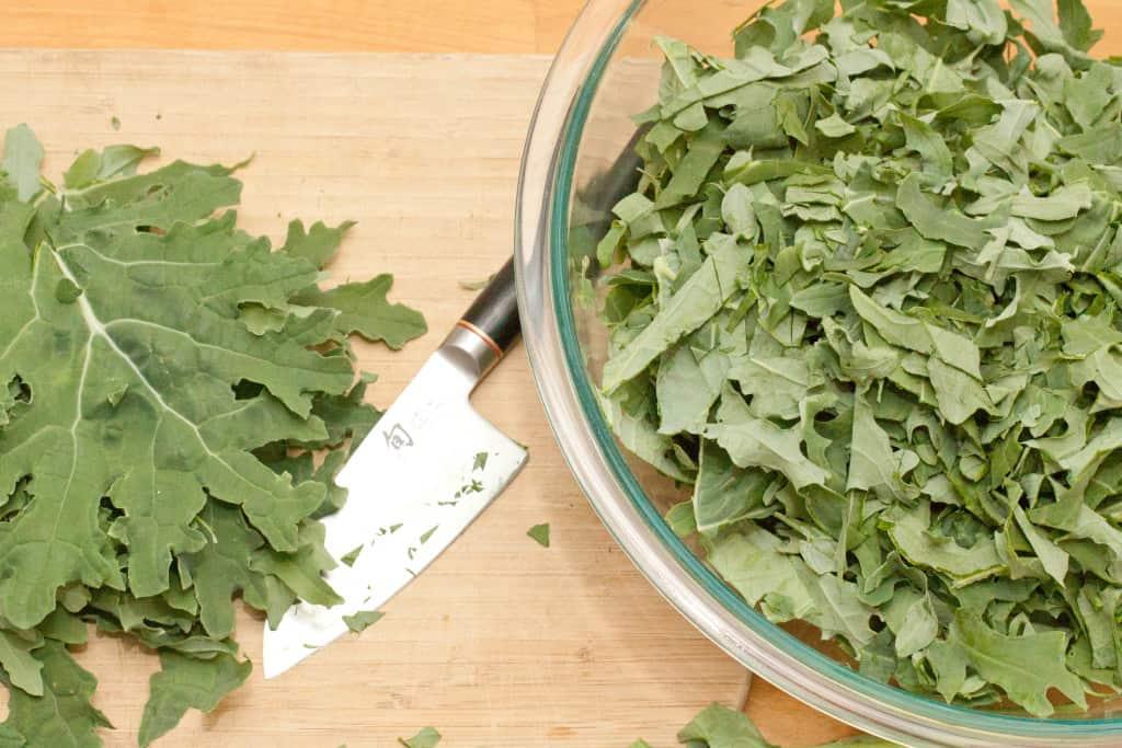fresh kale chopped in a bowl.