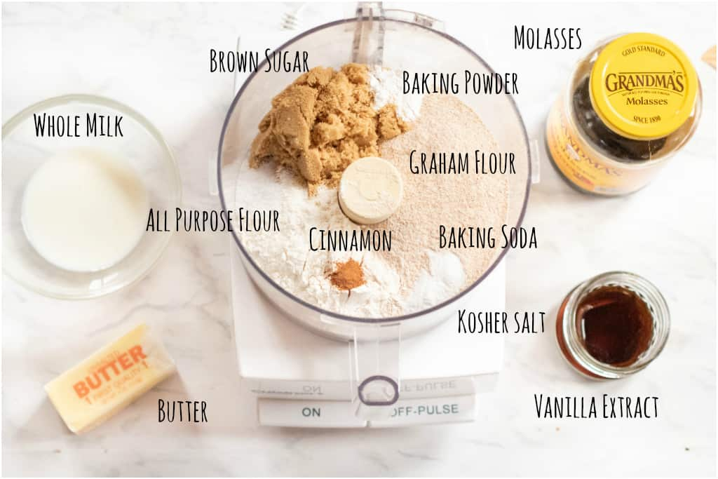 a food processor with ingredients in it for graham crackers with milk, butter, molasses, and vanilla