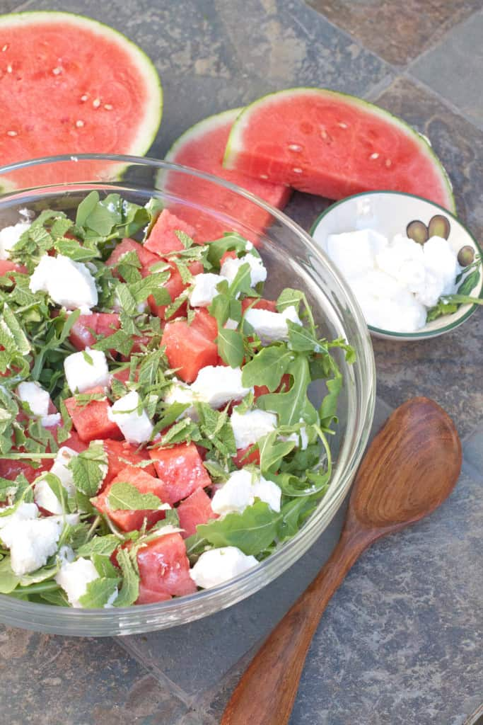 Arugula Watermelon Feta Salad in a large bowl undressed