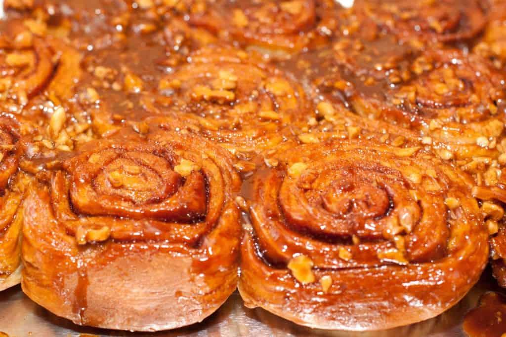 fresh baked sticky walnut coated cinnamon rolls.