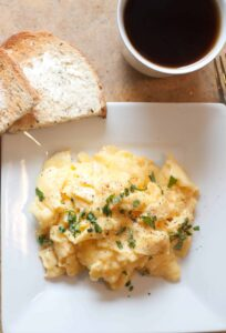 The perfect soft scrambled eggs with Parmesan and Basil!