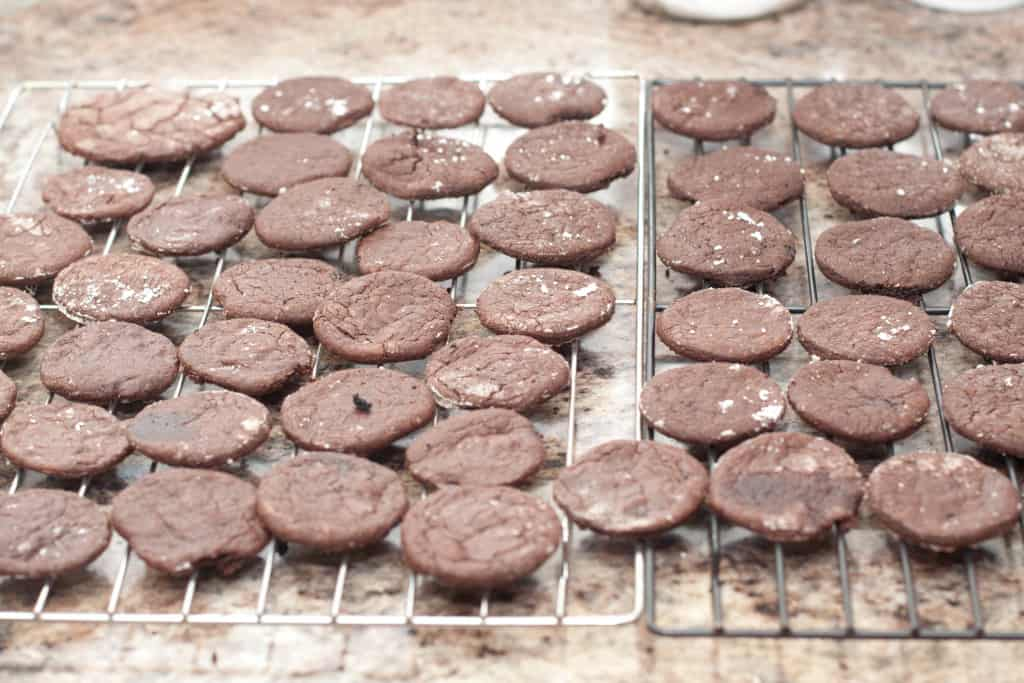 cooked round chocolate cookies on cooling racks