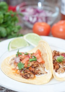 Crock Pot Chicken Carnitas Tacos are your ultimate taco Tuesday meal thanks to the weeknight ease of your trusty Crock Pot!