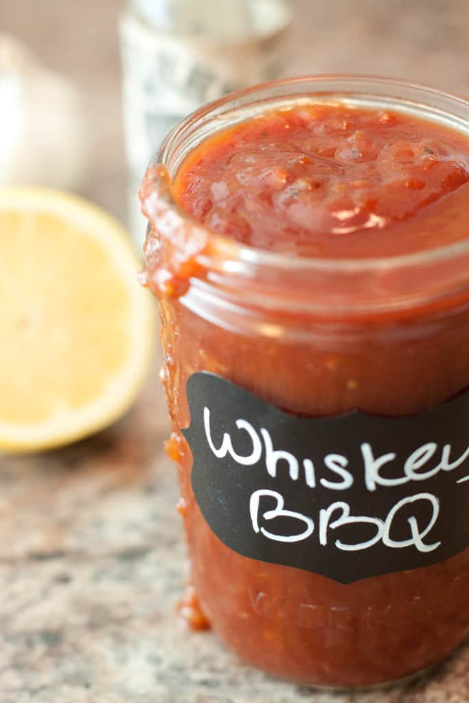 a close up of an open jar of whiskey bbq sauce.