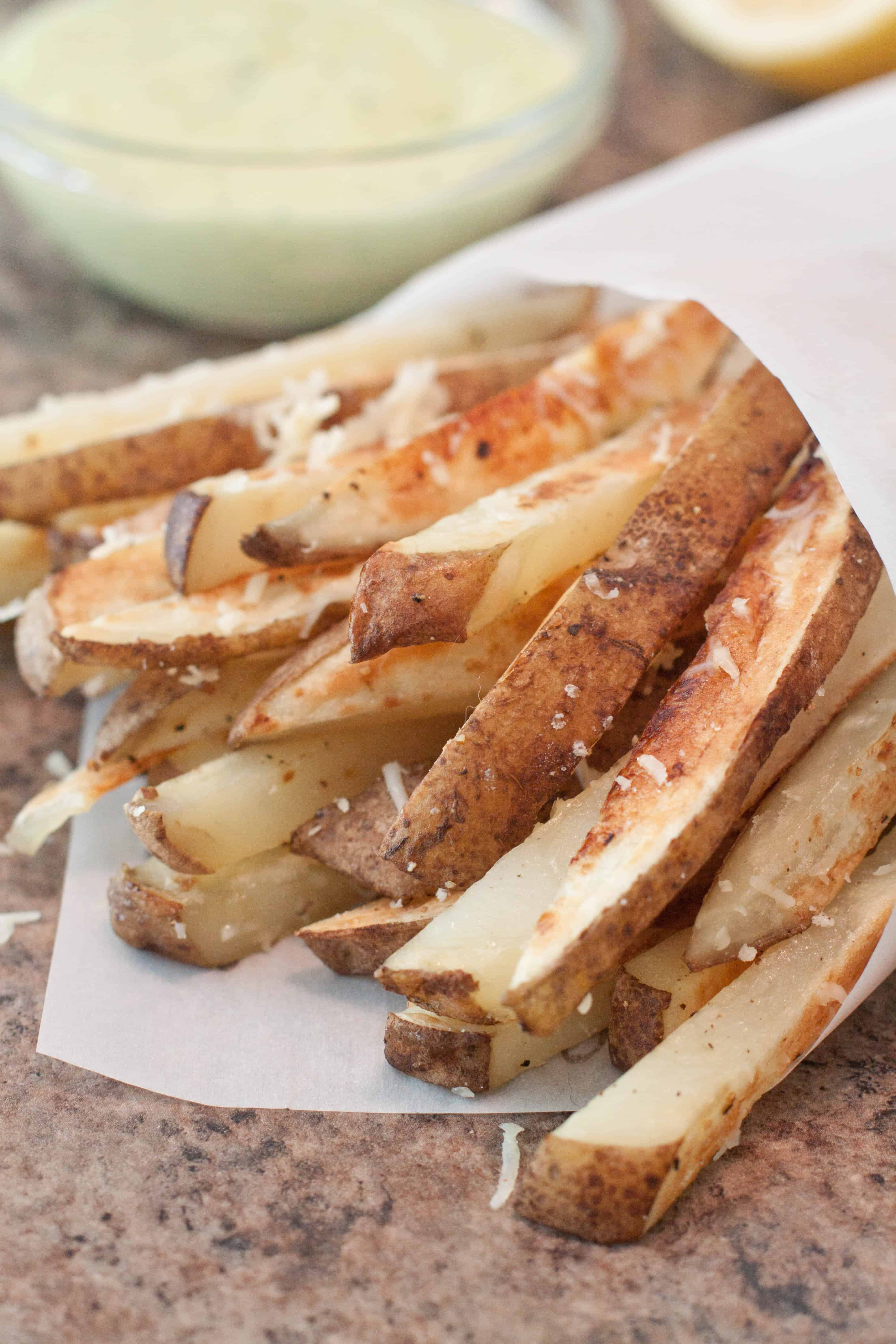 Homemade Baked Parmesan Steak Fries served with a super easy Garlic Aioli are a healthy and delicious alternative for that french fry craving