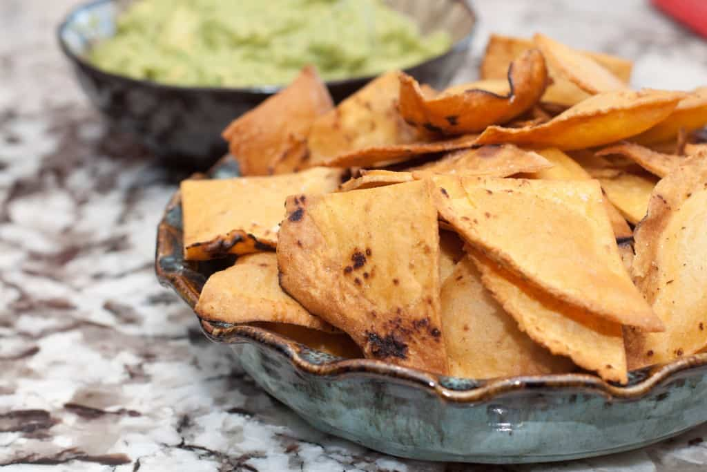 Corn tortilla chips from scratch in a bowl.