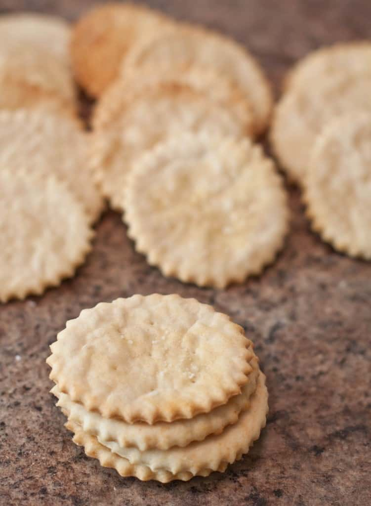 stacked ritz crackers on a counter.