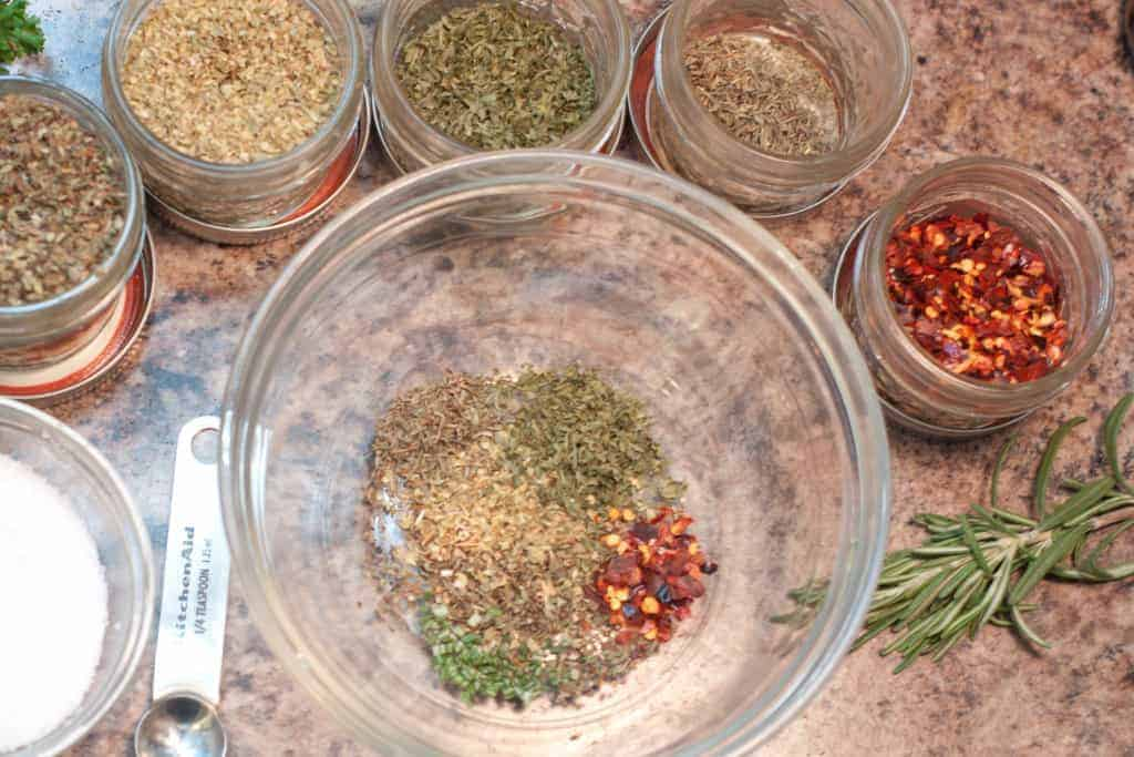 a small bowl surrounded by spice jars