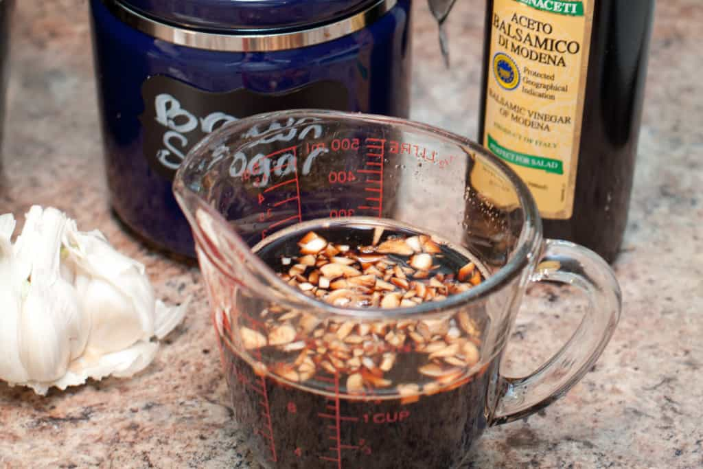 measuring cup with balsamic and garlic