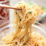 chopsticks holding up noodles