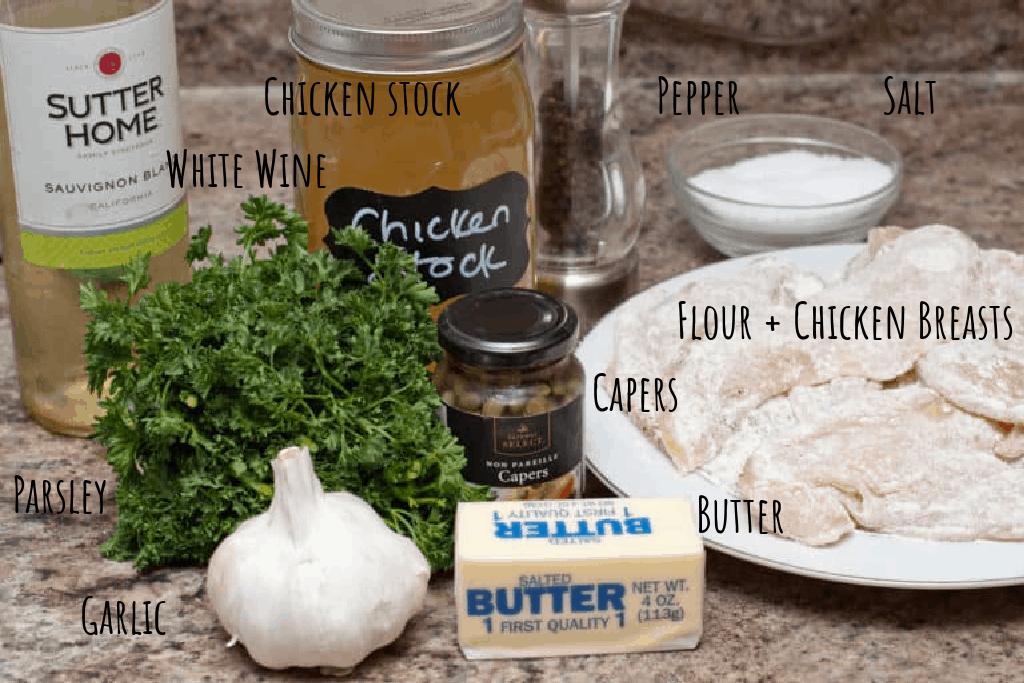 floured chicken, chicken stock, salt, pepper, capers, fresh parsley, garlic, butter, and white wine on counter