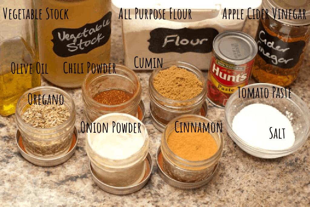 stock, oil, flour, cider vinegar, spices, salt, tomato paste on counter