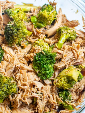 a bowl of shredded chicken and broccoli.