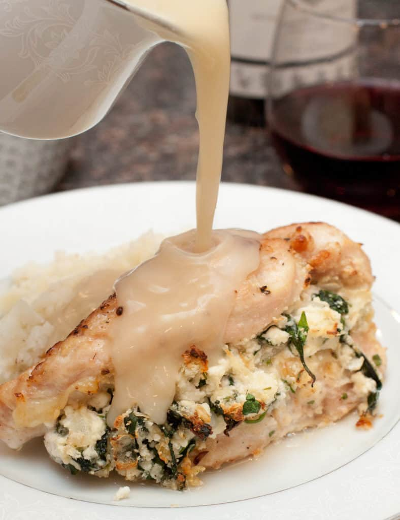Fresh Ricotta and Spinach Stuffed Chicken is a dinner that will taste like you slaved in the kitchen all day but is easy enough for a weeknight dinner!