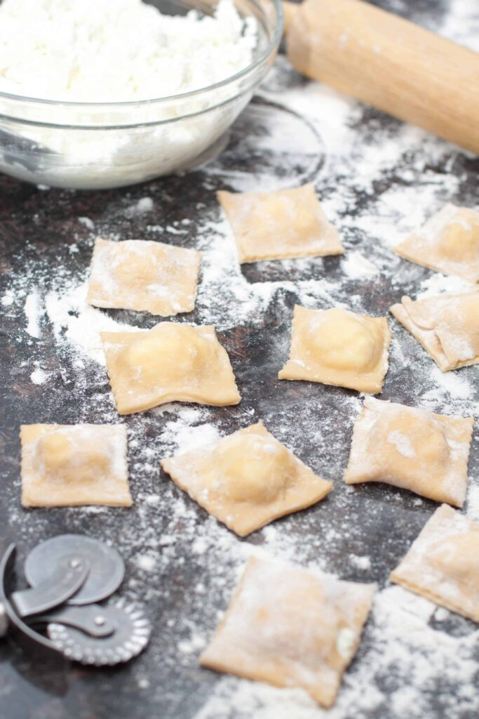 Fresh homemade ricotta cheese inside fresh rolled pasta for the most delicious Fresh Ricotta Ravioli you'll ever eat.