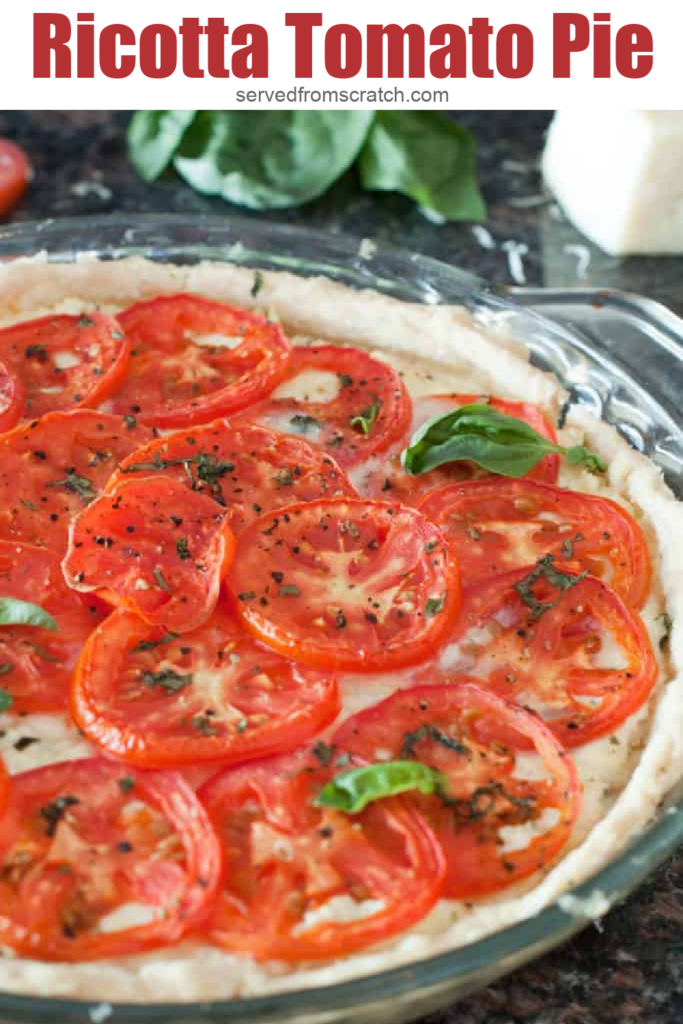 a baked pie of tomatoes and ricotta topped with basil and Pinterest pin text.