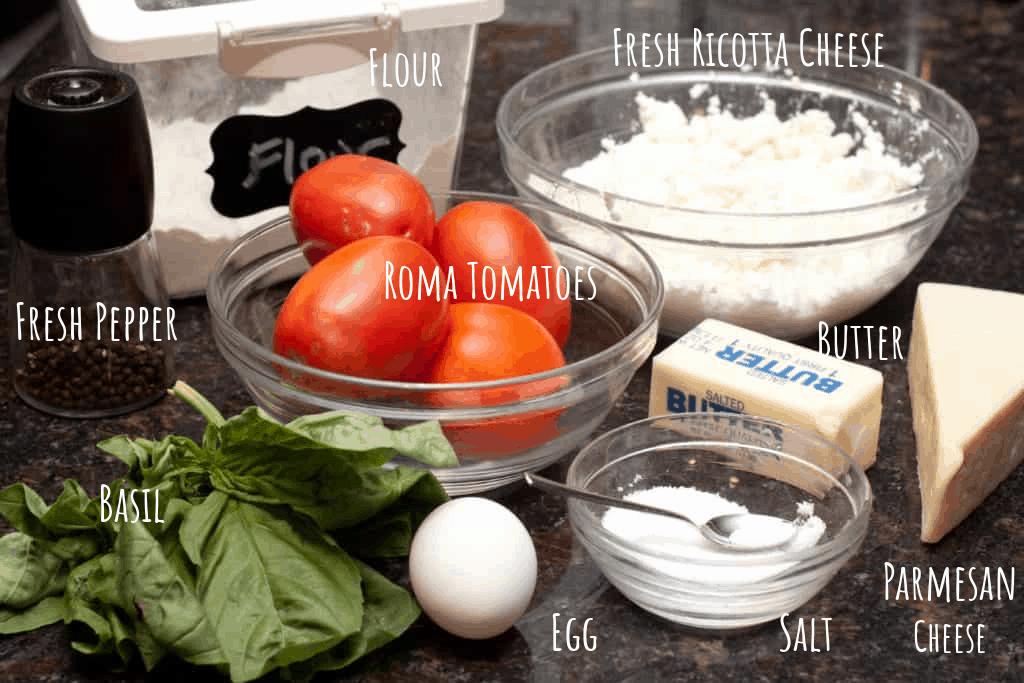 flour, pepper, ricotta, tomatoes, basil, egg, butter, parmesan cheese, salt on counter.