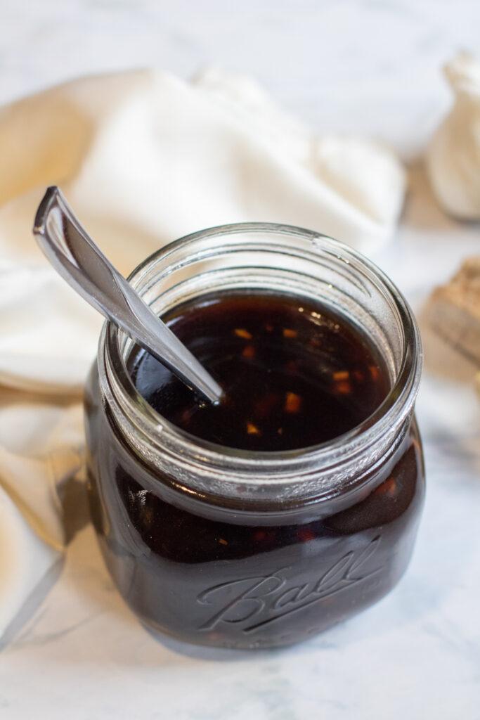 a jar of teriyaki sauce with a spoon