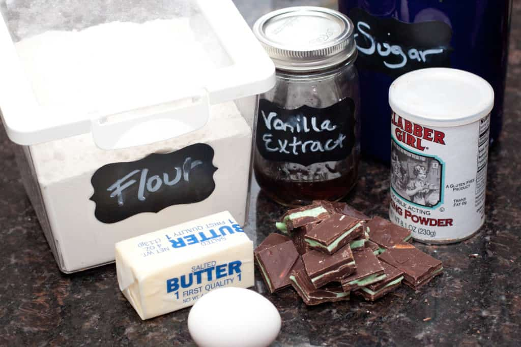 flour, butter, egg, andes mints, vanilla extract, sugar and baking powder on counter